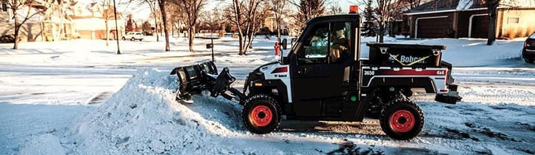Piling the Snow with an UTV