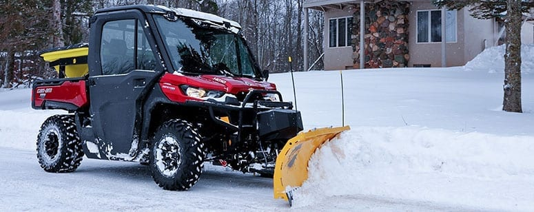 plowing snow with an UTV
